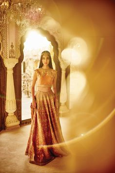 Amidst the luxurious hues of soft apricot, crystal chandeliers and antique vases, she stands, waiting to hold her #besties bouquet. The picture-perfect #bridesmaid. #TheWeddingDiaries by #AnitaDongre #pheras #destinationswedding #1135AD