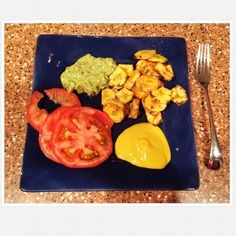 Fried in olive oil plaintains, guac (garlic, avocado, tomatoes, onions, lime juice)