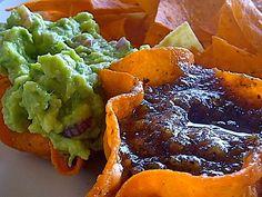 Fresh guacamole and salsa with chili infused hacienda-made chips