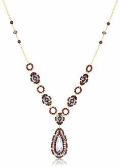 """Miguel Ases Garnet and Swarovski Station Pendant Necklace Miguel Ases. $300.00. Store in the provided suede pouch in a dry place. 3"""" extension. Miguel Ases provides its customers with a lifetime repair guarantee at no additional cost. Made in United States. Handcrafted in the United States"""