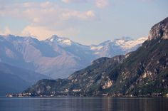 Marco MCMLXXVI posted a photo: Tresures of Lombardy Onno. Italy. Lake Como, The village of Varenna and the mountain range called Muncech; the highest summit is named Pizzo Cavregasco. Il lago di Como, il villaggio di Varenna e la catena dei Muncech, con il Pizzo Cavregasco. Dalla riva di Onno. Took this from a place that is just ten minutes of driving from the place where I work. One of my colleagues knew that I was looking for a tele lens, and he is trying to sell me this camera with a…