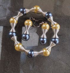 Pearls, Pearls, Pearls, and More Pearls...Yellow, Gray  Pearl BraceletElegant and Earring Set with swirls on Etsy, $10.00