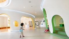 A Tree-Inspired Beijing Daycare | Azure --- Bursts of vibrant colour adorn the kid-friendly shapes of Sako Architects' Familybox early childhood education centre.