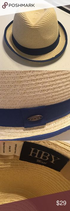 Panama Hat with Navy Grosgrain Ribbon Panama Hat with Navy Grosgrain Ribbon - Comfy straw hat great for resort season. Never worn! From HBY Miami. Take this beach hat with you when you go! HBY Accessories Hats