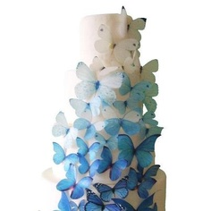 Here's your something blue :) Blue butterfly cake toppers that are edible!  Via incrEDIBLEtoppers on Etsy. For more #weddingcake inspiration visit www.modernweddingblog.com.