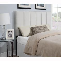 Ivory king/California king size upholstered panel headboard is handcrafted for the ultimate in comfort and style. This plush upholstered headboard is generously padded and can be attached to most standard metal bed frames