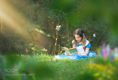 Alice with her nose in a book by Maria_Arellano