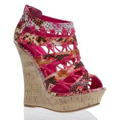Perfectly designed for comfort and style. Love the strappy wedge with pattern!