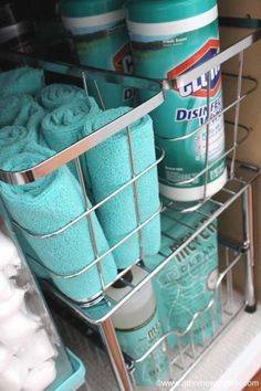 Tired of the clutter under your sink? Use baskets, stackable shelves, and more organizing systems to spruce up this overlooked space. Get the tutorial at At Home With Nikki. #organizingyourhome #organizingclutter #homeorganizationtips