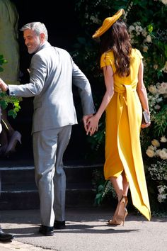 Amal Clooney looks beautiful in yellow for the royal wedding- HarpersBAZAARUK