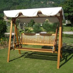 Add a touch of classic elegance to your patio furnishings with this Royal Tahiti outdoor swing, featuring a sturdy Yellow Balau hardwood build. This swing also offers a stylish A-frame design, and an ivory outdoor polyester fabric canopy.