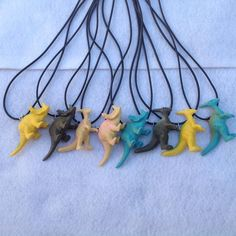 8 Dinosaur Necklace Party favors. inspired by by ChicbyRose