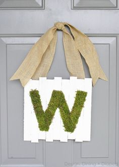I started with a Valentine's Day Pallet, I just finished an Easter Pallet and now I have for you a little Moss Monogram Pallet Sign for your front door (or anywhere!).