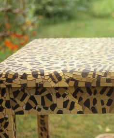 Mosaic leopard print table