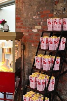A stair turned popcorn table. Popcorn Stand, Popcorn Boxes, Popcorn Station, Popcorn Bar Party, Wedding Popcorn Bar, Popcorn Favors, Popcorn Snacks, Wedding Themes, Party Themes