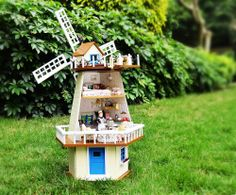 Free Shipping Diy Doll  House waiting for manual assembly rotating windmill villa wooden model of monsoon creative gift $79.83 **I have bought from this seller and they are reliable. the kits are completely DIY and include EVERYTHING you see in the pictures including the lights.**