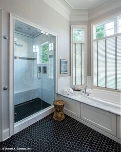 Walk-in shower and soaking tub in the master bathroom! The Monarch Manor home design 5040. #WeDesignDreams