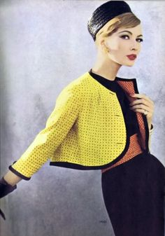 vintage- That silhouette is so sweet! I'm digging the short jacket with the gloves meeting the sleeves. That interior color and matching belt is so cute!