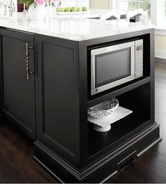 Microwave Nook Save counter space with a built-in microwave within your kitchen island. Keep in mind that the island will be need to be outfitted with the proper electrical components. Also consider how the microwave door will open; make sure the appliance is in a place where the door won't run into anything. Kitchen Island With Cooktop, Island Cooktop, Kitchen Island Storage, Microwave In Kitchen, Farmhouse Kitchen Island, Modern Kitchen Island, Kitchen Redo, New Kitchen, Kitchen Islands