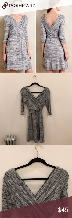 """Anthropologie Amardi Gray wrap dress Gorgeous heathered gray wrap dress from Anthropologie. Comfortable, stretchy, thick knitted material. Worn 2-3 times, in great condition no stains, holes etc. *downsizing, everything must go! Bundles of 3+ items get an automatic 20% discount at checkout. Offers on individual listings are considered via the """"make an offer"""" feature only.. I can usually ship next day! Anthropologie Dresses Midi"""