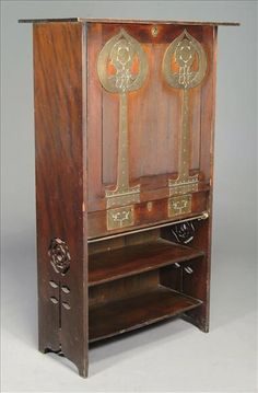 EARLY CABINET BY MACKINTOSH,WAS STAINED GREEN ORIGINALLY