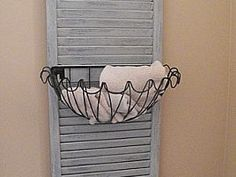 Shutter caddy. Hold towels indoors or out by the pool use to hold sunscreen, bug spray, towels, etc.