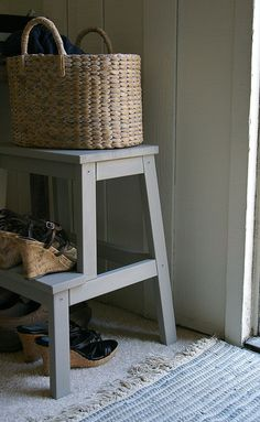 blue IKEA BEKVÄM step stool, wicker basket, shoes, entrance way