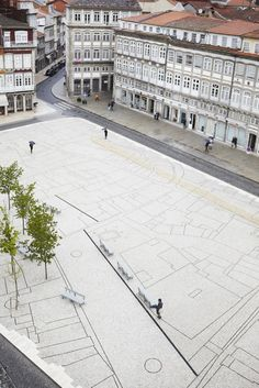 The Praça do Toural, Portugal. Trapezoidal space anchored by old fountain and renovated with new paving that looks like a map of the town.