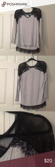 Beautiful hi lo WHBM top with lace detail Beautiful M hi lo WHBM top with lace detail. Heathered gray shirt with beautiful black lace detail on the shoulders and the hem in back. The gray material is so soft. EUC. I have a pair of black faux leather H&M jeans in another listing that are so fabulous paired with this. 😍 White House Black Market Tops