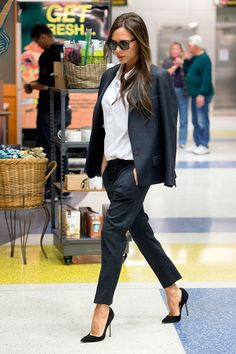 Victoria Beckham's Modern Take on the Pantsuit  (trousers hit just below ankle, sleek stilettos, jacket thrown over shoulders & crisp white button down... Sophisticated Cool)