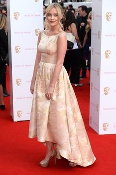Laura Whitmore's pretty peach dress was complimented by her loose half-up style, a soft, romantic red carpet look #BAFTA #redcarpet #hair
