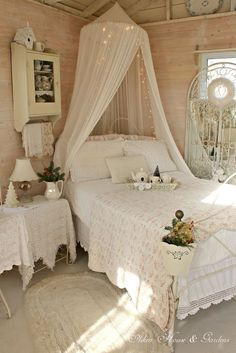 canopy with lights, white wrought iron bed