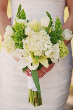 Bridal bouquet like this with hydrangea, bells of Ireland, hypericum berries, stephanotis, grass?, dusty miller, lambs ears