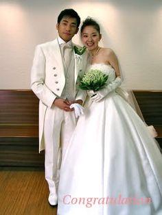 Japanese Skating Star Nobunari Oda and Bride in their wedding photo.  Source: BlazingBlades.com PhotoLog