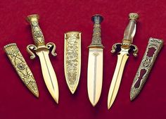 "Handmade Knives • Knifemaker & Copyright: Buster Warenski Photos: • The Gem of the Orient | The King Tut Dagger | Fire & Ice • The King Tut Dagger "" Source: Custom Knife Collector's Association """
