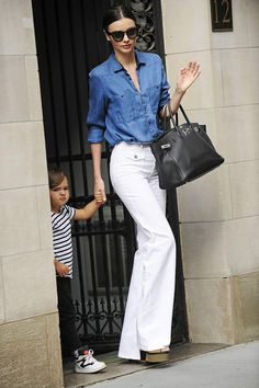 Miranda Kerr in white wide leg jeans and a chambray top. #NYC