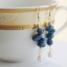 I think we are going to start the @Alissa Futilini needs to tell my boyfriend to buy these for me list again. EOLA. Earrings. Fresh Water Pearls. Natural Stones. Dark Blue. Nuggets..