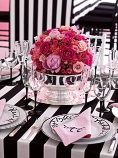 Brides.com: Wedding Color Scheme: Black, White and Pink. Rich with Roses  Used to wrap favors and loop over centerpieces, dotted and striped ribbons tie together the overall color scheme, adding wit and texture to the mix.  White Platinum Border dinnerware, Carnegie Hill flatware, and silver bowl and platter available for rent from Party Rental Ltd. Linen monogrammed napkins, Initial It Yours. Flowers, Christopher Bassett, 646-285-7140. Calligraphy, Maria Thomas of Pendragon Ink.