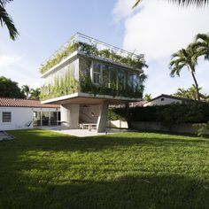 Another view of the house, with the original Spanish bungalow just behind it.-Wmag