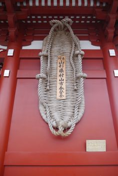 """This pair of huge traditional straw sandals called """"O-Waraji"""" had been made by 800 citizens of Murayama City in a month and devoted to Senso-ji Temple, Tokyo's Buddhist temple.  O-Waraji is made of straw and 2500 kilograms in weight, 4.5 meters high.  They are the charm against evils because they are symbolic of the power of """"Ni-Ou"""".  Wishing for being goodwalkers, many people will touch this """"O-Waraji""""."""