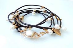 pearl bracelet brown lether cord3 round wrist by inbalmishan, $80.00