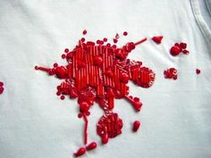 Embroidered blood stain by Lesage   http://www.stylink.nl/borduren.html