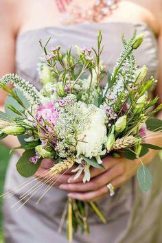 beautiful hand tied bridesmaids bouquet arranged with white pink lavender green florals wildflower wedding bouquetswild