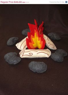 felt fire - love,love,love - has felt stick with velcro and felt weiner to roast, as well as s'more stuff