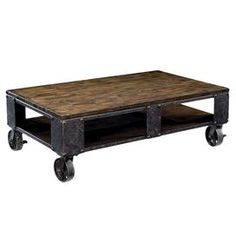"""Wood-topped coffee table with a distressed iron frame and metal casters.        Product: Coffee table       Construction Material: Hardwood solids, pine veneer, iron and metal     Color: Distressed natural pine   Features:   Rectangular shape    Contemporary accents    Casters for mobility    Dimensions: 17"""" H x 52"""" W x 32"""" D    Note: Assembly required"""