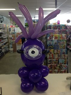 Purple minion table centrepiece made from balloons.