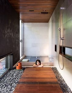 Japanese style wet room. Stone and wood open shower next to separate hot tub and cold tub. High ceilings and doors that open make it absolutely perfect.