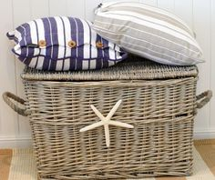 This basket is a good example of beachy fiber (wicker) in a driftwood color. Also like the striped pillows. Classic nautical look. Seaside Decor, Beach Cottage Decor, Coastal Cottage, Coastal Homes, Coastal Style, Coastal Living, Coastal Decor, Cottages By The Sea, Beach Cottages