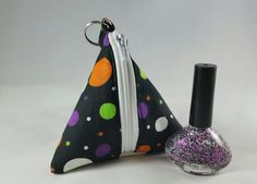 Check out this item in my Etsy shop https://www.etsy.com/listing/477367615/spooky-spots-triangle-polish