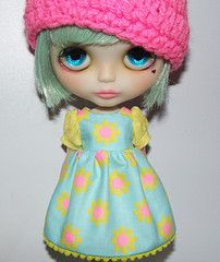 Love the pink hat and light blue hair.